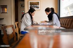 Stock Photo : young designers discussing in cafe