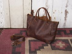 http://www.forestbound.com/collections/frontpage/products/ashcroft-leather-carryall