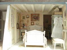 room of a quaint dollhouse..love the beams.