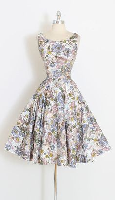 ➳ vintage 1950s dress  * gorgeous polished cotton * floral print with front side covered in sequins * metal side zipper * full skirt  condition | excellent fits like medium  length 43 bodice length 17 bust 38-39 waist 27-28 hem allowance 2  some clothes may be clipped on dress form to show best fit for appropriate size.  ➳ shop http://www.etsy.com/shop/millstreetvintage?ref=si_shop  ➳ shop policies http://www.etsy.com/shop/millstreetvintage/po...