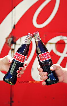 Cheers to you, cheers to Coca-Cola!