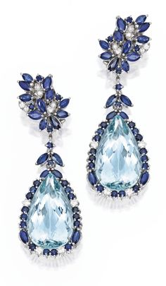 Pair of White Gold, Aquamarine, Sapphire and Diamond Pendant-Earrings. Anchored by two pear-shaped aquamarines weighing approximately 67.00...