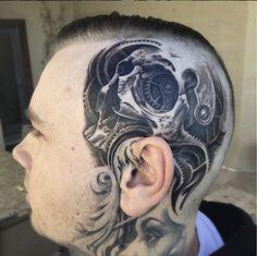 This realistic mecahnical skull tattoo was tattooed by Josh Duffy. #InkedMagazine #tattoo #tattoos #inked #art #headtattoo #domepiece #skull