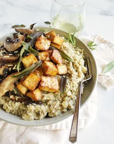 Mushroom cauliflower risotto is a lighter & veggie loaded alternative to regular risotto. It's packed with hearty herbs & topped with crispy tofu. Cauliflower Mushroom, Cauliflower Risotto, Asian Slaw, Tofu Dishes, Crispy Tofu, Mushroom Risotto, Slaw Recipes, Risotto Recipes, Tempeh