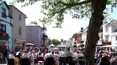 Bridport, a delightful market town in the UK, the town band in the square on a market day