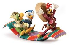 """WDCC Disney Classics Three Caballeros Panchito, Donald and Jose Airborne Amigos #WDCCDisneyClassics #Art. That quixotic quackster Donald Duck journeys into South America with dapper José Carioca from Brazil and ebullient Panchito the Mexican rooster as his tour guides. Panchito graciously invites his two amigos to accompany him on """"a nice little trip to Mexico on the magic serape."""" This multi-colored magic carpet sweeps the birds-of-a-feather trio over the beautiful land of song and dance."""