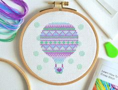 Up, up and away! This adorable hot air balloon cross stitch kit from The World In Stitches comes complete with 16 page tutorial booklet containing instructions and tips to help perfect your new hobby. Cross Stitch Needles, Cross Stitch Kits, Cross Stitch Charts, Cross Stitch Designs, Cross Stitch Patterns, Cross Stitch Tutorial, Hot Air Balloon, Cross Stitching, Craft Stores
