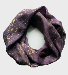 Naturally dyed by hand, this scarf feels luxe in thin and lightweight silk. Hand-dyed in beautiful hues, this infinity scarf can be wrapped around and around for supreme comfort. The speckle pattern, created with water-based ink, complements the vibrant fabric and we wouldn't be too surprised if you started to feel a little like royalty, even in your office chair.