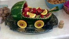 Add orange slices and grapes for the wheels. Fill with fruit and enjoy!