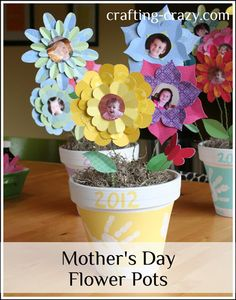 Adorable handprint pots with photo flowers inside.  Too cute not to try! #DIY #Crafts #MothersDay