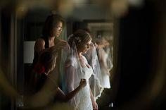 Beautiful image of the bride getting ready by Maloman Photographers | via junebugweddings.com