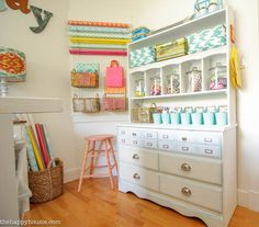 Colorful Cheery Craft Room Tour at The Happy Housie | Love those huge jars! A fun & pretty way to display colorful craft supplies.