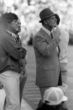 Assistant Coach Dan Reeves stands behind Dallas Cowboys head coach Tom Landry, as Landry tries to figure out a fix for the Cowboys falling behind the Steelers in Super Bowl X in Miami.
