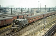 https://flic.kr/p/ygtuwL | Pennsylvania RR SW1 9418 switching the Broadway Limited, Chicago, IL on September 14, 1965 | The flat end observation car is Mountain View a Pullman Standard Light Weight 2 master bed room - 1 bed room - buffet lounge observation car.  For car diagram see: www.flickr.com/photos/129679309@N05/21212689351/in/datepo...