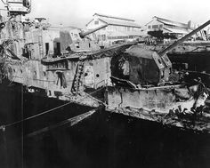 In this image provided by the U. Naval Historical Center, USS Downes in dry dock No. Pearl Harbor Navy Yard, Hawaii in December where she was struck by enemy bombs during the Japanese raid on Dec. Naval Historical Center via The Associated Press