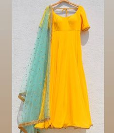 Pure Georgette bumblebee yellow anarkali with turquoise blue net (sequin handworked dupatta enhanced with lace). Colour Combination For Dress, Yellow Color Combinations, Colour Combinations Fashion, Color Combinations For Clothes, Indian Designer Outfits, Indian Outfits, Indian Dresses Traditional, Mode Bollywood, Blue Dress Outfits