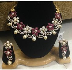 Radhika's - lovely set in rubies, diamonds and pearls - invisible setting