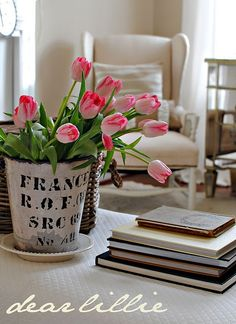 sweet tulip arrangement. wingback reading chair to enjoy a good book in.