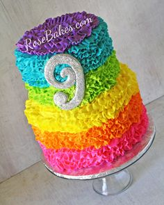 I want to do a rainbow ruffle cake like Gina's pink one. Maybe I'll do rainbow sixlets on top? Or ponies?
