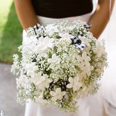 I'm not a big fan of Stephanotis but I really like it paired with the baby's breath and ribbon detailing in this bouquet.