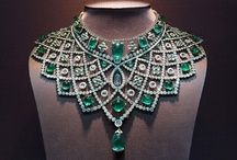 The emerald diamond necklace belonged to the last Queen of Italy: Queen Marie Jose. She was known for her amazing collection of her jewels and amid those awesome collection is this beautiful necklace.  http://www.charleskoll.com/product-category/wedding-bands/
