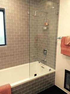 Amazing use of the Smoke Glass Subway Tile in the shower surround and tub front, very modern. https://www.subwaytileoutlet.com/products/Smoke-Glass-Subway-Tile.html#.VpaijLiDFBc