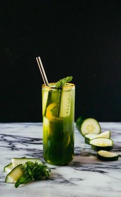 Cucumber Basil Lemonade- A refreshing and hydrating summer sipper! Full of cucumbers, lemons and herbaceous basil, a perfect drink from the Kale and Caramel cookbook.