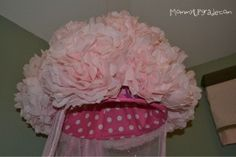 How to make a canopy from a laundry basket, fabric, tissue paper, and tulle