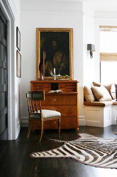 Inspiring Decorating Ideas For Rentals // antique secretary desk, zebra hide rug, cushioned window seat, antiques, Grant K. Gibson