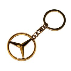 Mercedes Benz Merc Keyring Gold. The ideal gift for any Mercedes Benz fan! Stunning key ring with famous Mercedes Benz Merc Logo