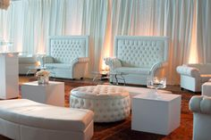 Crystal loveseats, Crystal round ottoman, White Cube End Tables, and Continental Curved benches