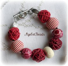 polymer clay bracelet. one of a kind, hand made beads.  - I, of course, looked at it and thought it was a set of prayer beads... (-:
