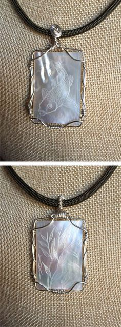 """HEADS or TAILS. Two-sided engraved mother of pearl pendant wire-wrapped with tarnish resistant silver copper wire on a 16"""" dark olive chord. From The Gorilla Guild on etsy.com."""