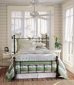 Bedroom, wrought iron headboard and footboard, green, white, bedding, linens, comforter, plank walls, cottage, coastal