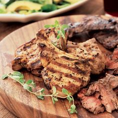 The adobo, or marinade, adds a tangy, garlicky flavor to the grilled steaks and pork chops and also tenderizes them. Plus: More Grilling Recipes and Tips. Grilling Recipes, Pork Recipes, Wine Recipes, Mexican Food Recipes, Cooking Recipes, Mexican Dinners, Recipies, Grilled Pork Chops, Grilled Meat
