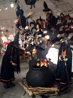 Joe Spencer's Witches on the flying brooms working their magic on the cauldron full of the smaller dolls!