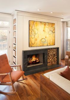 Off-centre fireplace with wood storage to right and large abstract art work above