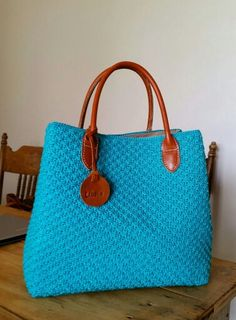 Libelle Natural Bags : This hancrafted crochet bag has a devider to keep your valuable things safe. It's trendy and functional in a bag. And the color is just amazing.