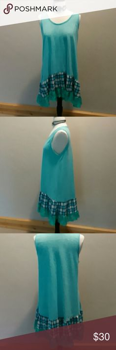 New plus size tunic This lovely mint green tunic has a plaid and lace ruffle along the hemline. Perfect for a summer day. 100% polyester Tops Tunics