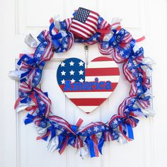 Patriotic wreathe for the summer month holidays (Memorial Day/4th of July). Spent about $13 to make. Used ribbon from Michael's and heart from Dollar Tree.