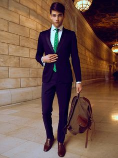 I just love how the suit, shoes and green tie with the bag put together. So loved it.