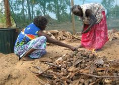 Australian Aboriginal healers Djerrkngu Marika (L) and Babalangua Munungurr of the Yolngu clan prepare a fire with bush medicines, as part a...