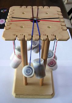 Jan Buday - Glass Jewelry Artist - Japanese Kumihimo Classes- interesting loom with film canisters as the bobbins Card Weaving, Loom Weaving, Diy Bordados, Lucet, String Crafts, Passementerie, Macrame Tutorial, Homemade Jewelry, Bijoux Diy