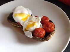 Slimming world free breakfast: large flat mushroom stuffed with baby plum tomatoes, seasoned well to you liking (I used Italian herbs) and topped with poached egg.