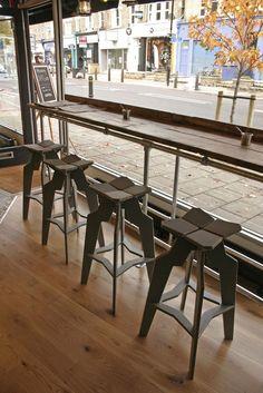 Rustic wood flooring design and metal bar stool coffee shop design inspiration .