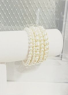 Gorgeous 5 strand Swarosvki Pearl bracelet, perfect for a statement bracelet for your wedding or special occasion!  Multi Strand Pearl Bracelet with round and by AliChristineBridal, $60.00