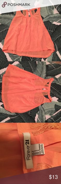 Forever 21 Lace back Tank Really cute Tank. Light orange, lace detail on back. Make and offer! Or bundle with other things! I am moving and cleaning out my closet! Forever 21 Tops Tank Tops