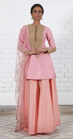 Rimple & Harpreet Narula. Blush pink Chanderi silk short kurti with delicate tilla-dori embroidery; paired with a soft tulle dupatta and peach pink silk sharara.