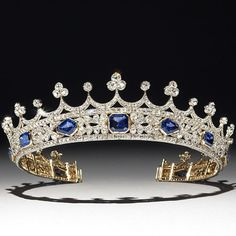 An important tiara, designed by Prince Albert for Queen Victoria, who is seen wearing it in the painting by Winterhalter of 1842. She wore this delicate jewel on her first public appearance after Albert's death, recording the event in her diary. It is set with diamonds and sapphires. Private Collection.