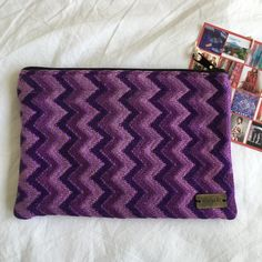 Ketzalia purple chevron print handmade clutch A standout piece and a handmade one of a kind! Promotes fair trade and sustainable fashion! Great clutch or make up bag. NWT retail. 5.5 inches tall by 7.5 inches wide. Ketzali Bags Clutches & Wristlets